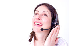 Laughing is healthy. Beautiful young woman working in a telephone customer service, photography Royalty Free Stock Images