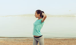 Beautiful young woman workout on beach Royalty Free Stock Photography