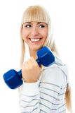 Beautiful young woman works out with dumbbells Royalty Free Stock Image