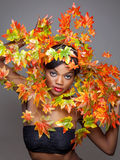 Beautiful young woman wrapped in leafs Royalty Free Stock Image