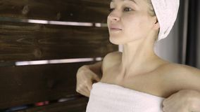 Beautiful young woman wrapped in towel. Skin care and home Spa stock video footage