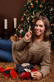 Beautiful young woman wrapping Christmas present Stock Image