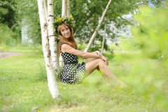 Beautiful young woman near the birch Royalty Free Stock Photos
