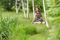 Beautiful young woman near the birch Royalty Free Stock Images