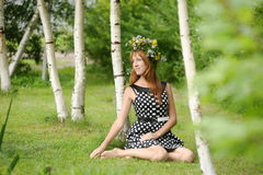 Beautiful young woman near the birch Royalty Free Stock Photography