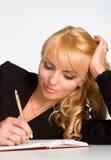 Beautiful young woman writing Stock Photos