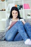 Beautiful young woman writing Stock Photo