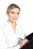 Beautiful young woman writing in a file Royalty Free Stock Photography