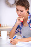 Beautiful young woman writing something in her. Note pad Royalty Free Stock Photos