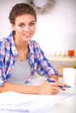 Beautiful young woman writing something in her note pad.  Royalty Free Stock Images