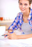 Beautiful young woman writing something in her note pad.  Stock Photo