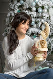 Beautiful young woman  and xmas tree Stock Images