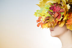 Beautiful young woman with yellow autumn wreath Stock Images