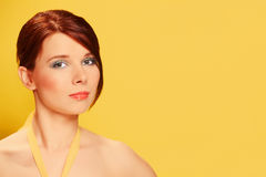 Beautiful young woman on yellow background Stock Photo