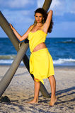 Beautiful young woman in a yellow dress Royalty Free Stock Photo