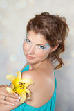 Beautiful young woman with yellow flower Stock Photos
