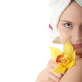 Beautiful young woman with yellow orchid Stock Image