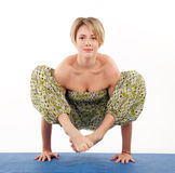 Beautiful young woman in yoga pose Royalty Free Stock Image