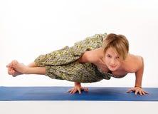 Beautiful young woman in yoga pose Stock Photos