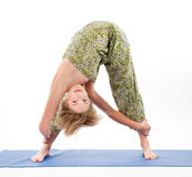 Beautiful young woman in yoga pose Royalty Free Stock Images