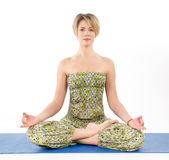 Beautiful young woman in yoga pose Stock Image