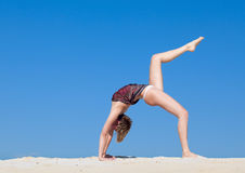 Beautiful young woman in yoga pose Stock Images