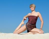 Beautiful young woman in yoga pose Stock Image