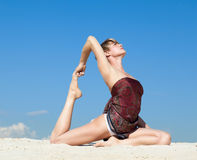 Beautiful young woman in yoga pose Stock Photo