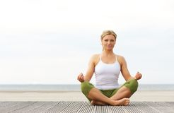 Beautiful young woman in yoga position outdoors Stock Photos