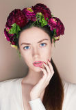 Beautiful young womanl with flowers hairstyle Stock Photos