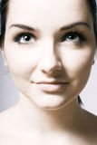 Beautiful young womans face Stock Photography