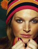 Beautiful young women. Wearing worm colored hat and scarf Stock Photography