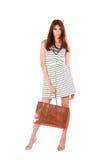 Beautiful young women carrying shopping bag. Beautiful young woman carrying shopping bag, Isolated on white Stock Image