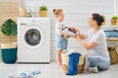 Family doing laundry royalty free stock photo