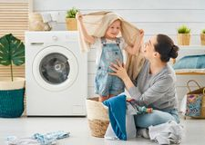 Family doing laundry royalty free stock images