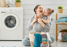 Family doing laundry royalty free stock photography