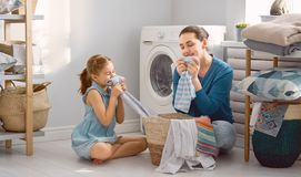 Family doing laundry stock image