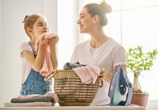 Mother and daughter ironing at home Stock Photography