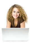Beautiful young women on the computer. A pretty teenager using a portable computer Stock Image