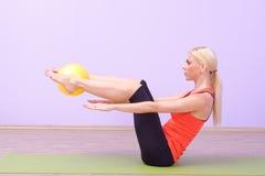 Beautiful young women doing Pilates Stock Image