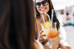 Beautiful young women drinking cocktails Stock Image