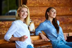 Young women drinking tea stock images