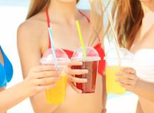 Beautiful young women with drinks Royalty Free Stock Photography