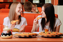 Beautiful young women eating pizza Royalty Free Stock Image