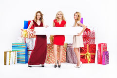 Beautiful young women with empty board Royalty Free Stock Photo