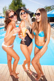 Beautiful young women are enjoying drinks on Royalty Free Stock Photos