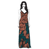 Beautiful young women in a fashion long dress. Bright floral pri Royalty Free Stock Images