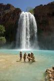 Beautiful Young Women in front of Havasu Falls. Beautiful group of women standing in front of the world famous Havasu Falls in Arizona stock photography
