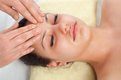 Beautiful young women getting a face massage Stock Photography