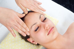 Beautiful young women getting a face massage Royalty Free Stock Photo
